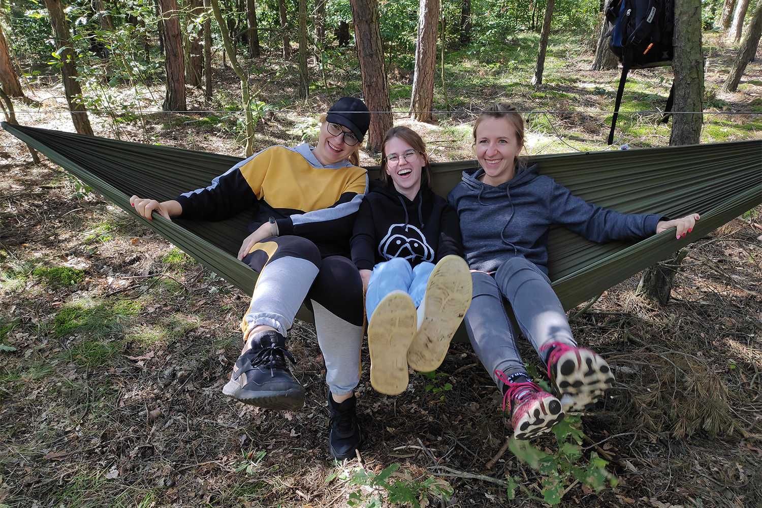 Employees in a hammock: successful team building activity and game outside the office.